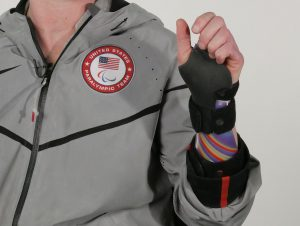 Cassie Brace wearing Paralympic jacket