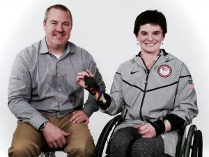 Neal Counts and Cassie showing arm brace