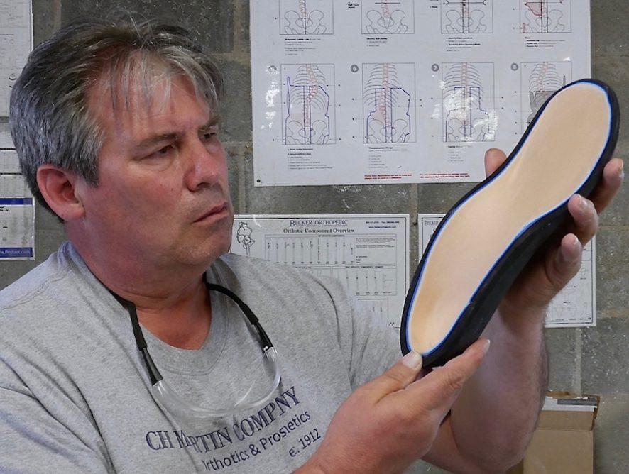 Rich inspects custom foot insert